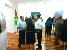 Pastor Fikri meeting Bolivians in Coral Gables during a cultural art exhibit.