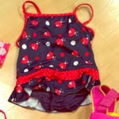 Toddler navy ladybug bathing suit. 3T 3T, cross cross straps, great condition! Swim