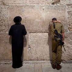 Wailing wall in Jerusalem. In the crevasses of the wall are millions of prayers written on paper for God to hear.