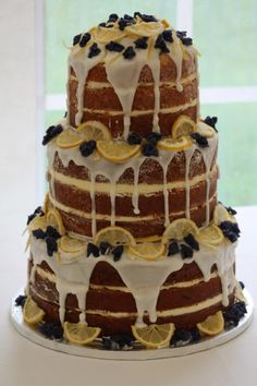 lemon drizzle naked cake decorated with crystallised whole violets and candied lemon - ideal for a rustic themed wedding