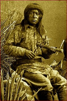 Apache man playing a one stringed instrument with a bow. One of the few stringed instruments used by Native Americans in their music. Photographed between 1883 and 1888.