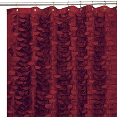This hand-crafted shower curtain has layers of silky, circular motifs to create a fantastic ruffle from top to bottom. The dimensional surface of the shower curtain will add motion and interest to your bath decor.