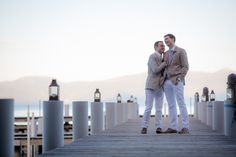 Jeff and Sebastian's wedding suits featured tan jackets, blue ties and white pants. The gay grooms married by the water on Lake Tahoe. Read their Real Wedding feature on Equally Wed.