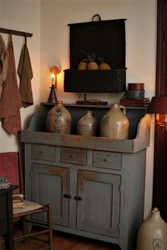 Wonderful milkpaint cabinet in this primitive room