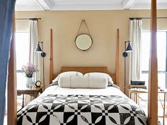Swoon: This pine four-poster bed is draped with an 1840s quilt.