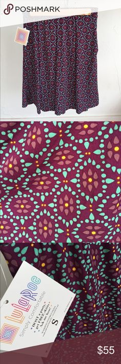 BNWT!! LuLaRoe Madison, Small This Lularoe Madison skirt is so gorgeous!! It features a gorgeous royal purple base color with lighter purple and yellow flowers with real decoration around the flowers! It is a soft and silky material and feels AH-MAZING when worn! It is brand new, never worn, only tried on! LuLaRoe Skirts Midi