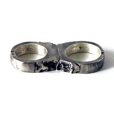 Completely custom set of Sterling Silver nesting rings that look as though they were once one.