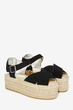Just telling you flat-out that you need that cork heel suede strapped flatforms in your life.