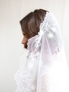 This is a beautiful vintage veil from the 1930s. It is an oval shaped veil and it can be worn mantilla style or doubled over and thrown over the face.