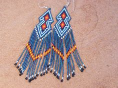 Southwestern Native American Beaded Double Diamond Shaped Earrings in the Colors of Pearl White and Deep Metallic Blue by LJ Greywolf These beaded double diamond shaped dangle earrings are made up of
