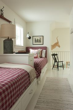 James Thomas Chicago: Sweet country boys bedroom with built-in twin beds with storage drawers filled with red ...