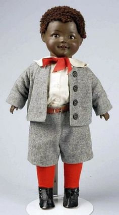 """17"""" composition and cloth boy doll with earthenware head, designed by American artist Jeanne Orsini, glass sleeping eyes, wearing original schoolboy outfit, Germany, 1920,"""