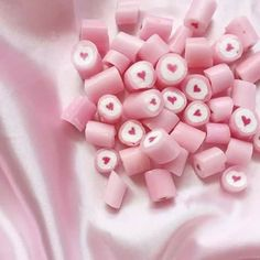 adorable pink candies with hearts in the center