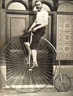 Penny-Farthing: Early form of bicycle with a huge front wheel & tiny rear wheel. Invented in 1871 by British engineer, James Starley, the name comes from the similarity between British penny & farthing coins, one being much bigger than the other. From the profile the bike looks like a penny leading a farthing. A Penny-Farthing was very hard & dangerous to use & only men were capable of riding them. Many a person was hurt while trying to stop, as the bike tended flip forward causing head inju...