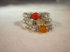 Set of three stretch rings in Mandarine Topaz by LoriLeaDesigns, $12.00 LOVE!