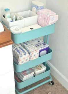 IKEA kitchen cart for nursery supplies.