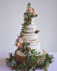 Semi naked cake with cascading foliage, berries and fresh flowers. Cake Couture NI