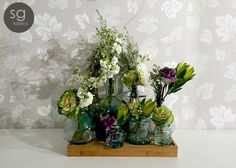 MIX AND MATCH TO YOUR HEART'S CONTENT - Group your vases together using different shapes, sizes, heights and even colours with one or two small bunches of rustic flowers to achieve this look Stuart Graham, Rustic Flowers, Bottle Vase, Different Shapes, Hot Springs, Vases, Fabrics, Colours, Content