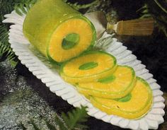 Hawaiian-style Jell-O...  Start by draining the juice from a can of pineapple rings and using it to mix with a package of lime Jell-O; add water if necessary. Pour the mixture back in the can of pineapple rings and chill.