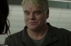 Gone too soon: Philip Seymour Hoffman, whose role as Plutarch Heavensbee was one of his final parts before his death in February last year, is also glimpsed in the clip