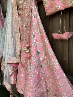"""Peach raw silk Lehenga choli. Handcrafted gota, French knots and crystal embroidery on the skirt and blouse. Intricate pattern adorn this pastel shade lehenga choli. Ivory net dupatta with peach embroidered borders. Fabric : Silk, netSkirt Length : 44"""" Delivery : Ready to shipOccasion : Wedding Ceremony/Reception/Enga"""
