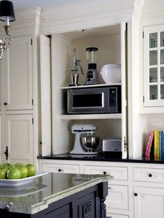 I like this idea for the kitchen. Hiding the microwave and toaster etc.