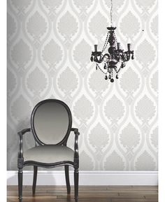 This Corona Damask Wallpaper in grey and ivory has an intricate damask pattern on a textured background with glitter and mica highlights. Free UK delivery available