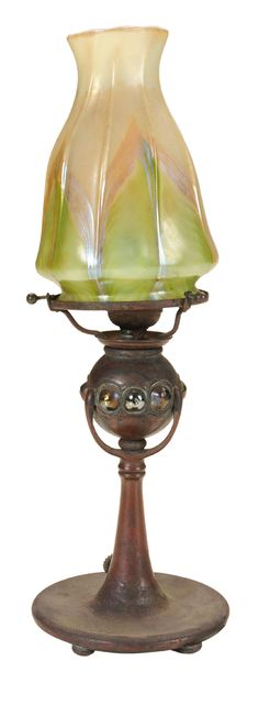 """Rare Tiffany Studios Bronze and Glass - Desk Lamp early 20th century, the patinated bronze base set with nine Favrile glass cabochons, base stamped """"Tiffany Studios New York 11405"""", with unmarked feathered art glass shade (possibly Tiffany)."""