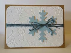Bailey Ray's handmade card. Embossed background w/ punched snowflake