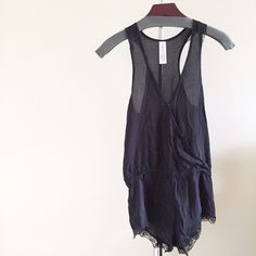 Black Lightweight Romper With Lace Detail. New without tag. Wrinkled from being folded but still in excellent condition. Only selling to make room. And sorry but I can't model. I'm currently 39 weeks pregnant and this doesn't fit at the moment. Thank you for not asking me to model. :) No trades. No PayPal. Forever 21 Dresses