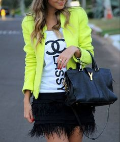 Feather skirt, chanel classy, pop of neon- what more can I ask for from an ensemble?!? #obsessed