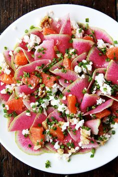 This goat cheese salad is a mix of watermelon radishes, Cara Cara oranges, toasted walnuts and goat cheese, dressed with shallots, olive oil, and chives.