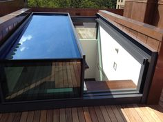 Bespoke two wall box rooflight. We've installed custom-built box rooflights fixed to two walls or one. It's your roof, so why not get involved in the design? You can specify bi-parting stacking, or slide the glass over the terrace itself to provide a 100% clear opening.