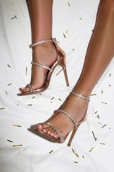 556a850f42bf52 Add extra sparkle to every ensemble with the Aerin Rose Gold Rhinestone  Ankle Strap Heels! These glam