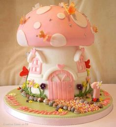 Cute pink toad stool house cake