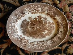 I need to start a brown transferware collection STAT!  A plate collection would look beautiful in our dining room on the wall.