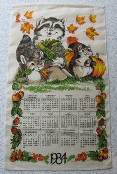 1984 Raccoon calendar linen tea towel.