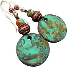 Boho Leather Patina Earrings  Each piece of leather is hand cut, hand tooled, a patina added and sealed to ensure the luster and color will last... genuine turquoise gemstones complement the character of each design. Large enough to make a bold statement, yet light enough to wear comfortably. The earrings measure approx 2 inches with sterling silver ear wires.