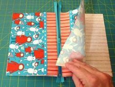 Easiest zipper pouch tutorial I've found -- has the best pictures to figure it out!