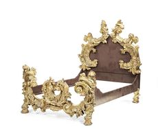 A North Italian late 19th century carved giltwood bed Probably Venetian