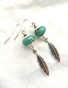 Turquoise and silver Lampwork Glass, silver feathers and sterling silver earrings.