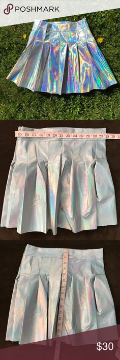 28/29 Holographic Skirt Brand new, tags on original packaging. Holographic skirt - high waisted ! Not unif. Waist measures 27.5in and can stretch up to 29in Size Medium.  Tags: Hologram, Holographic, harajuku, kawaii, Lolita, festival, rave, ravewear, dollskill, unicorn, omighty, shopjeen, wildfox, topshop, rainbow, grunge, little black diamond, metallic, silver leather UNIF Skirts Circle & Skater