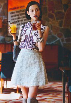 Kiko Mizuhara | patterned sleeveless blouse + textured skirt