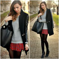 Grey sweater and a little longer skirt in red.