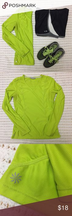 """Athleta Run Workout Long Sleeved Mesh Top Gorgeous lime green poly/spandex top with a patterned mesh on the back (see last photo) for breathability. Thumbholes, reflective strips on back, v-neck. Cute ruching on front. 17"""" armpit to armpit flat across and 23"""" shoulder to hem. Fits TTS and slightly big- I can wear an XS but wish this was tighter on me. In good condition. Hint: this looks great with the gray striped Under Armour workout capris that I have listed! 😍 Athleta Tops Tees - Long…"""