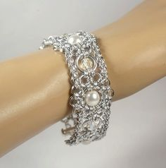 """Designed by Torild Larsen .   """"Anastacia"""" bracelet with white pearls and clear crystals, bright aluminum"""