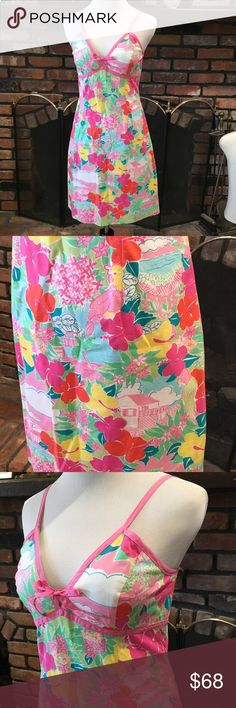Lilly Pulitzer island Print dress size 4 Lilly Pulitzer island Print dress size 4.  Beautiful floral island print dress.  Adjustable straps.  Fully lined.  Excellent condition.  White tag Lilly Lilly Pulitzer Dresses