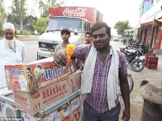 Not so sweet treat: A street-seller stands with his boxes of Hitler cones. Hitler's name a...