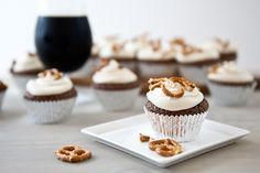 Chocolate AND booze? Count us in on these Chocolate Stout Cupcakes with Maple Bourbon Frosting and Pretzels!