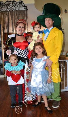 Alice in Wonderland family themed costumes. Queen of Hearts, Tweedle Dee and Tweedule Dum, Mad Hatter, Alice and the White Rabbit.
